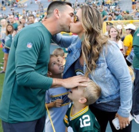 BreAnne LaFleur sharing a kiss with husband,