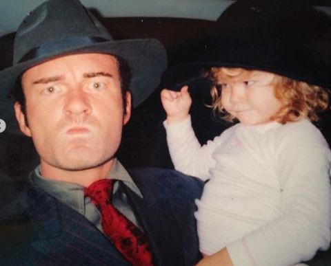 Julian McMahon holding his daughter, Madison Elizabeth McMahon (childhood photo).
