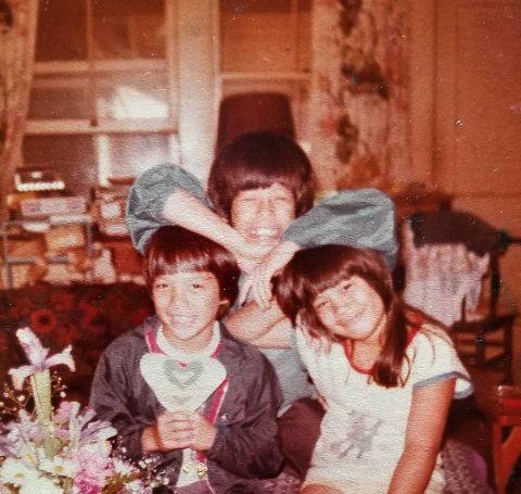 Kaliko Kauahi with her two brothers.