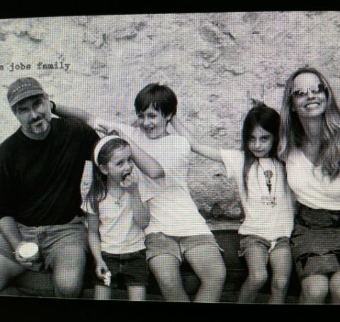 An old photo of Reed Paul Jobs with his family.