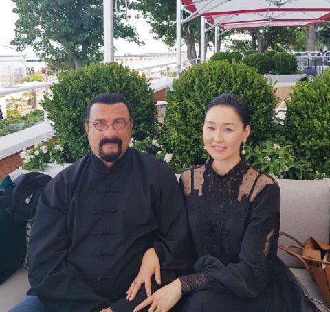 Steven Seagal with his current wife, Erdenetuya Batsukh.